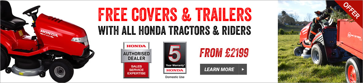 Honda tractors with covers and trailers